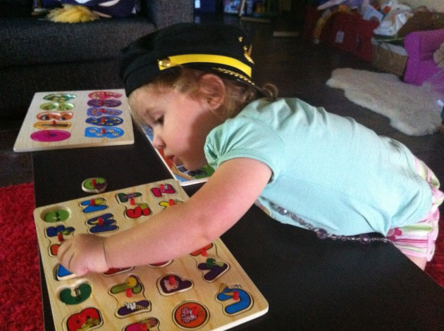 Lucy working on her puzzles